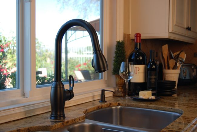 Stainless steel kitchen sink with bronze faucet