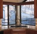 Corner kitchen sink with window