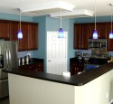 Cherry kitchen cabinets with blue walls